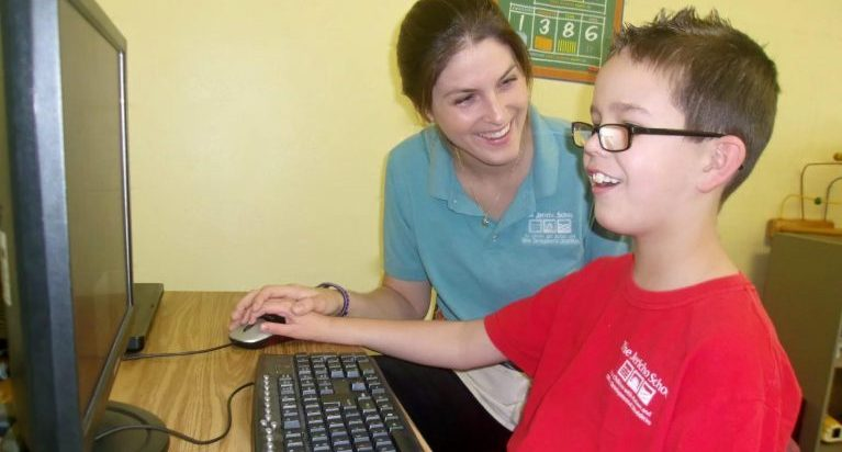 Tiffany Hunter Training a Student on a PC